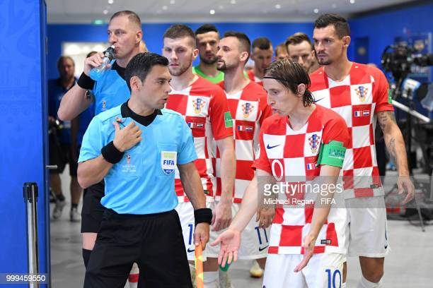 Luka Modric of Croatia ltalks to Assistant referee Juan Pablo Belatti before second half during the 2018 FIFA World Cup Final between France and...