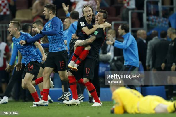 Luka Modric of Croatia Mario Mandzukic of Croatia England goalkeeper Jordan Pickford during the 2018 FIFA World Cup Russia Semi Final match between...
