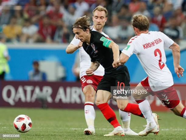 Luka Modric of Croatia national team vies for the ball with Christian Eriksen and Michael KrohnDehli of Denmark national team during the 2018 FIFA...