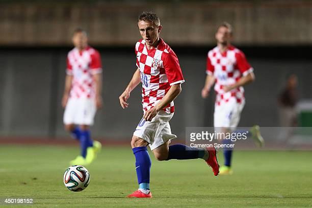 Luka Modric of Croatia passes during the International Friendly match between Croatia and the Australian Socceroos at Pituacu Stadium on June 6 2014...