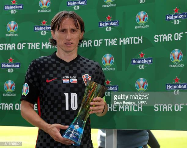"""Luka Modric of Croatia poses for a photograph with their Heineken """"Star of the Match"""" award after the UEFA Euro 2020 Championship Group D match..."""