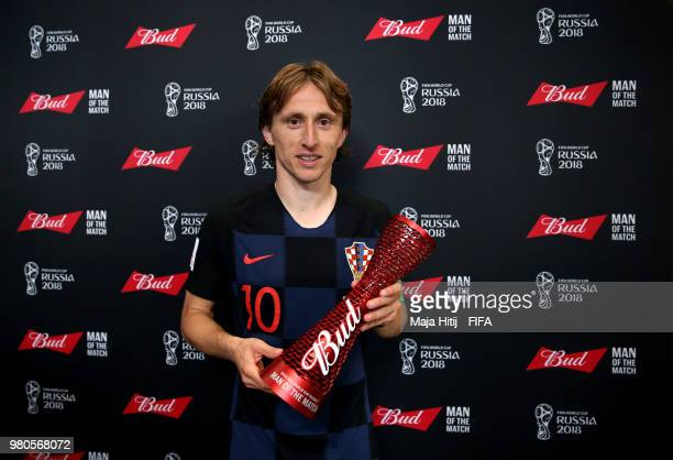 Luka Modric of Croatia poses with his Man of the Mathc trophy following the 2018 FIFA World Cup Russia group D match between Argentina and Croatia at...