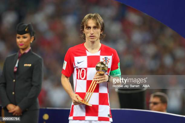 Luka Modric of Croatia poses with the FIFA Golden Ball for player of the tournament at the end of the 2018 FIFA World Cup Russia Final between France...