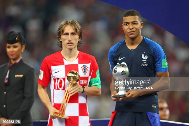 Luka Modric of Croatia poses with the FIFA Golden Ball for player of the tournament and Kylian Mbappe of France the silver ball for best young player...