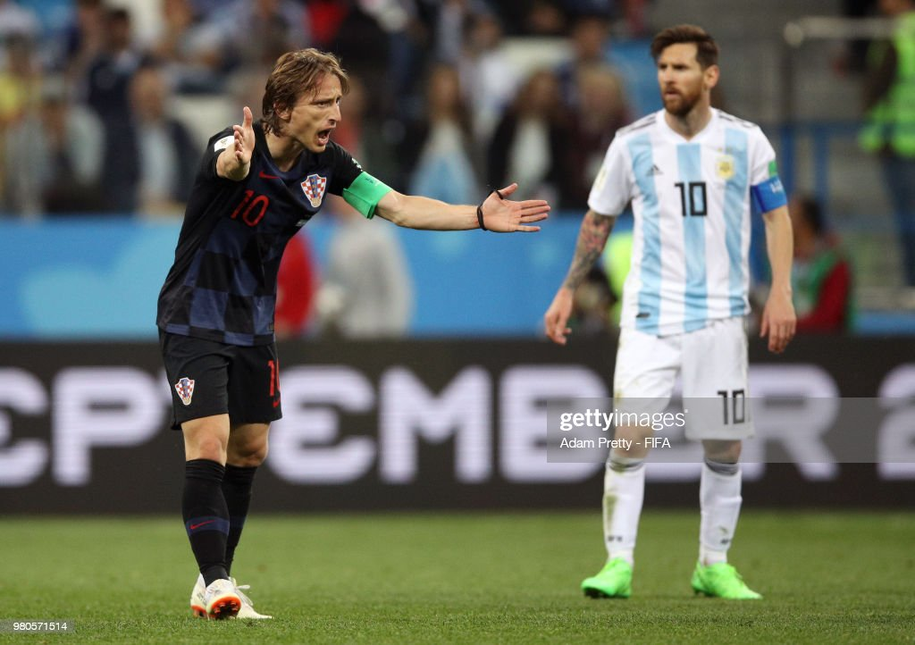 Luka Modric of Croatia reacts as Lionel Messi of Argentina looks on during the 2018 FIFA World Cup Russia group D match between Argentina and Croatia at Nizhny NovgorodStadium on June 21, 2018 in Nizhny Novgorod, Russia.