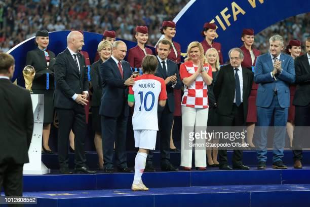 Luka Modric of Croatia receives his Player of the Tournament Award from FIFA President Gianni Infantino Russian President Vladimir Putin French...