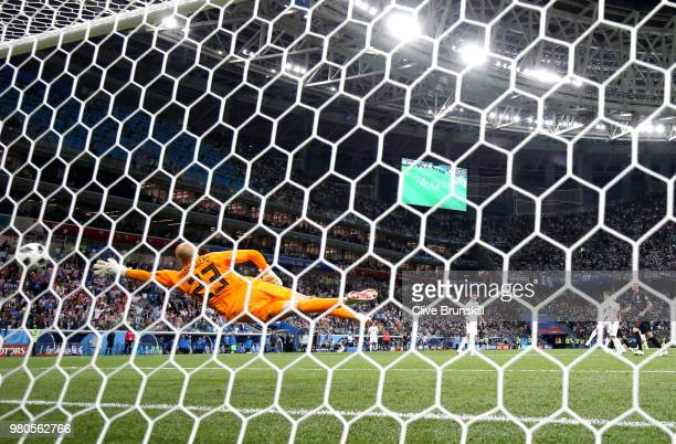 Luka Modric of Croatia scores past Wilfredo Caballero of Argentina his sides second goal during the 2018 FIFA World Cup Russia group D match between...