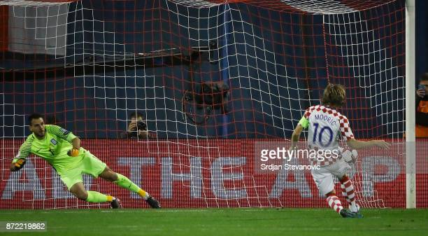 Luka Modric of Croatia scores the goal from penalty kick near goalkeeper Orestis Karnezis of Greece during the FIFA 2018 World Cup Qualifier PlayOff...