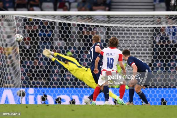 Luka Modric of Croatia scores their side's second goal past David Marshall of Scotland during the UEFA Euro 2020 Championship Group D match between...