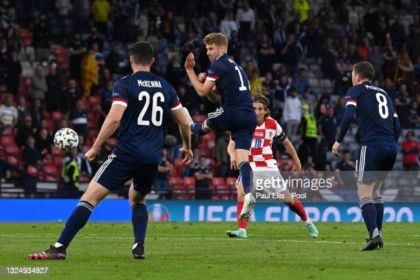 Luka Modric of Croatia scores their side's second goal whilst under pressure from Stuart Armstrong of Scotland during the UEFA Euro 2020 Championship...