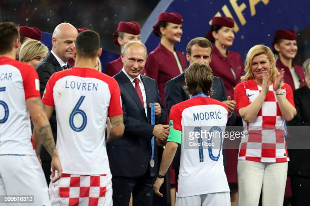Luka Modric of Croatia shakes hands with Vladimir Putin President of the Russian Federation following the 2018 FIFA World Cup Final between France...