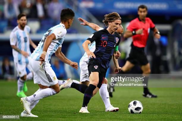 Luka Modric of Croatia takes on Javier Mascherano of Argentina during the 2018 FIFA World Cup Russia group D match between Argentina and Croatia at...