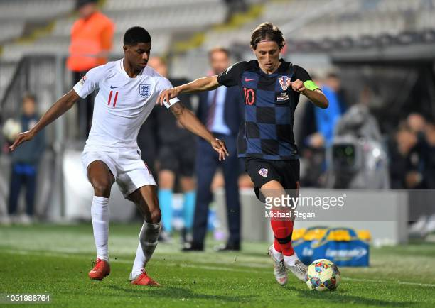 Luka Modric of Croatia takes on Marcus Rashford of England during the UEFA Nations League A Group Four match between Croatia and England at Stadion...