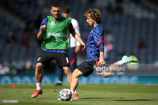 Luka Modric of Croatia warms up with team mate Mateo Kovacic prior to the UEFA Euro 2020 Championship Group D match between Croatia and Czech...