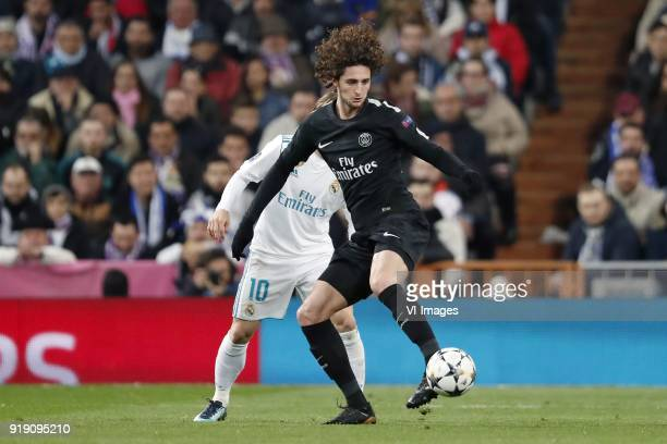 Luka Modric of Real Madrid Adrien Rabiot of Paris SaintGermain during the UEFA Champions League round of 16 match between Real Madrid and Paris...