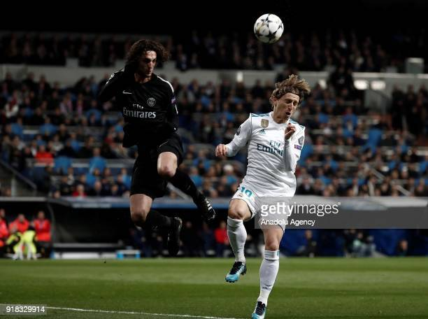 Luka Modric of Real Madrid and Adrien Rabiot of Paris SaintGermain vie for the ball during the UEFA Champions League Round of 16 football match...