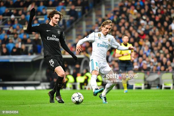 Luka Modric of Real Madrid and Adrien Rabiot of PSG during the Champions League match between Real Madrid and Paris Saint Germain at Estadio Santiago...