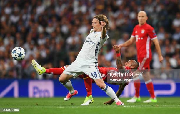 Luka Modric of Real Madrid and Arturo Vidal of Bayern Muenchen compete for the ball during the UEFA Champions League Quarter Final second leg match...