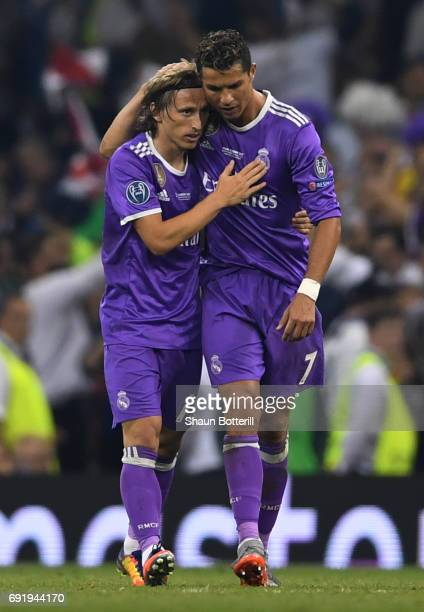 Luka Modric of Real Madrid and Cristiano Ronaldo of Real Madrid embrace after the UEFA Champions League Final between Juventus and Real Madrid at...