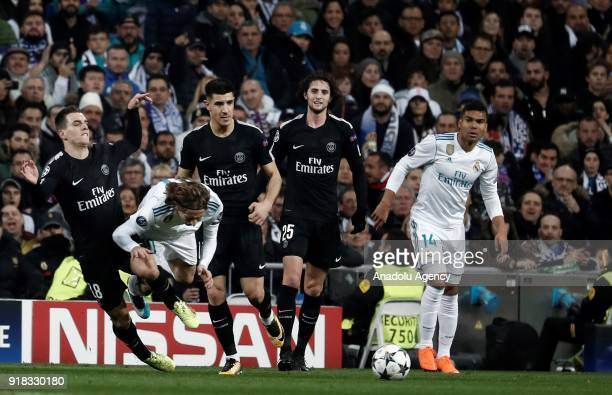 Luka Modric of Real Madrid and Giovani Lo Celso of Paris SaintGermain vie for the ball during the UEFA Champions League Round of 16 football match...