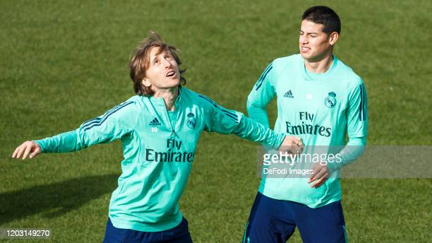 Luka Modric of Real Madrid and James Rodriguez of Real Madrid look on ahead of their UEFA Champions League round of 16 first leg match against...