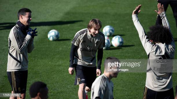 Luka Modric of Real Madrid and James Rodriguez of Real Madrid look on during the Real Madrid Training Session on February 21 2020 in Madrid Spain