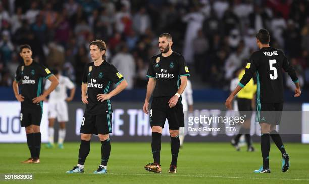 Luka Modric of Real Madrid and Karim Benzema of Real Madrid look dejected after Al Jazira score their first goal during the FIFA Club World Cup UAE...