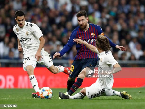 Luka Modric of Real Madrid and Leo Messi of Barcelona FC compete for the ball during the Copa del Semi Final match between Real Madrid and Barcelona...