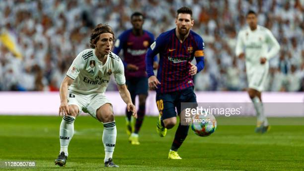 Luka Modric of Real Madrid and Lionel Messi of FC Barcelona battle for the ball during the Copa del Semi Final match second leg between Real Madrid...