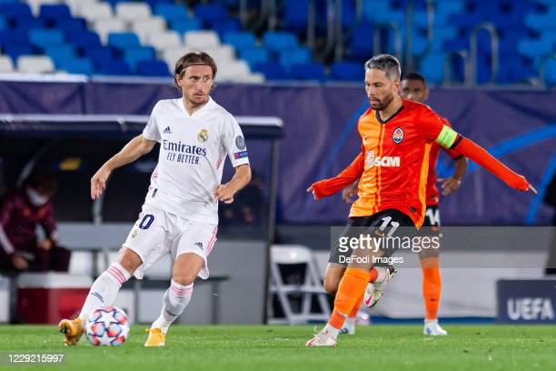 Luka Modric of Real Madrid and Marlos of FC Shakhtar Donetsk controls the ball during the UEFA Champions League Group B stage match between Real...