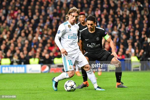 Luka Modric of Real Madrid and Marquinhos of PSG during the Champions League match between Real Madrid and Paris Saint Germain at Estadio Santiago...