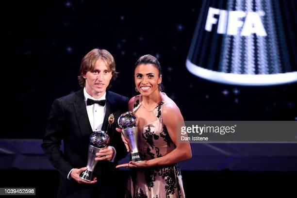 Luka Modric of Real Madrid and Marta of Orland Pride pose for a photo during the The Best FIFA Football Awards Show at Royal Festival Hall on...