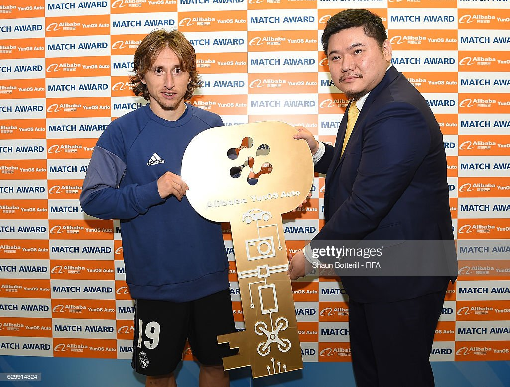 Luka Modric of Real Madrid and Mr. Cheng Li stand with the man of the match award during the FIFA Club World Cup Semi Final match between Club America and Real Madrid at International Stadium Yokohama on December 15, 2016 in Yokohama, Japan.