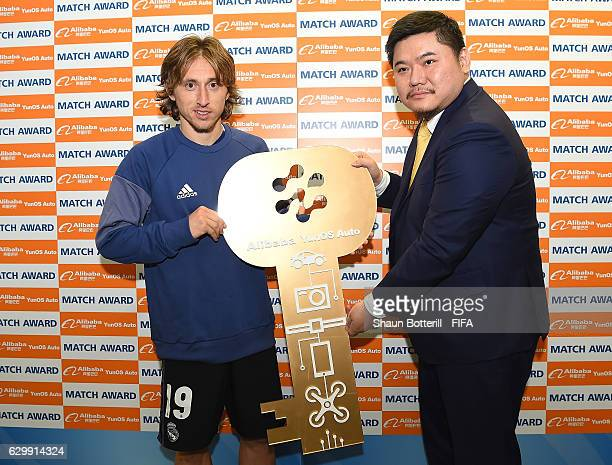 Luka Modric of Real Madrid and Mr. Cheng Li stand with the man of the match award during the FIFA Club World Cup Semi Final match between Club...
