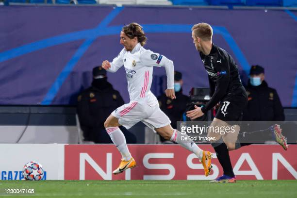Luka Modric of Real Madrid and Oscar Wendt of Borussia Monchengladbach battle for the ball during the UEFA Champions League Group B stage match...
