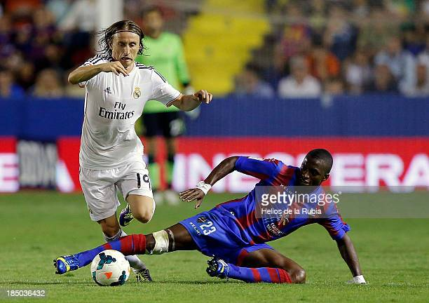 Luka Modric of Real Madrid and Pape Diop of Levante UD compete for the ball during the La Liga match between Real Madrid and Levante UD at Ciutat de...