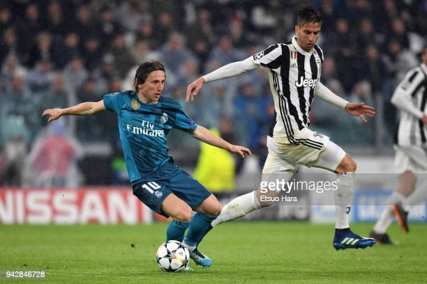 Luka Modric of Real Madrid and Rodrigo Bentancur of Juventus compete for the ball during the UEFA Champions League Quarter Final first leg between...