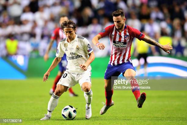 Luka Modric of Real Madrid and Saul Niguez of Atletico Madrid battle for the ball during the UEFA Super Cup between Real Madrid and Atletico Madrid...