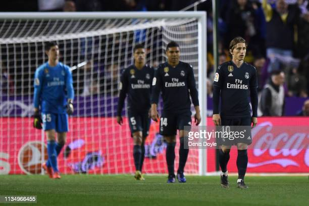 Luka Modric of Real Madrid and team mates look dejected as Anuar of Real Valladolid scores his team's first goal past during the La Liga match...