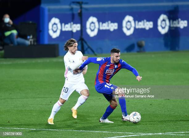Luka Modric of Real Madrid battles for possession with Edu Exposito of SD Eibar during the La Liga Santander match between SD Eibar and Real Madrid...