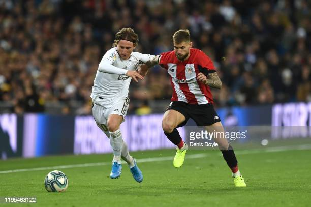 Luka Modric of Real Madrid battles for possession with Inigo Martinez of Athletic Club during the Liga match between Real Madrid CF and Athletic Club...