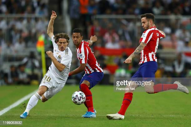 Luka Modric of Real Madrid battles for possession with Renan Lodi of Atletico Madrid and Saul Niguez of Atletico Madrid during the Supercopa de...