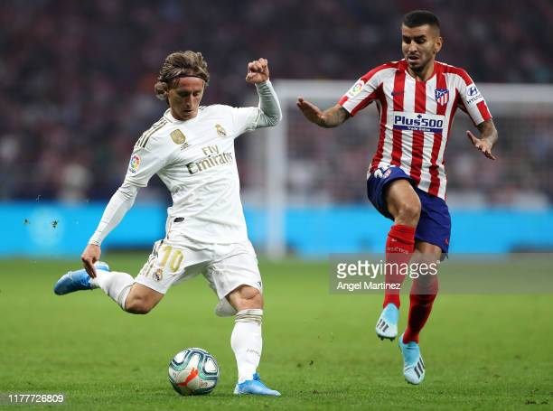 Luka Modric of Real Madrid battles for the ball with Angel Correa of Atletico Madrid during the Liga match between Club Atletico de Madrid and Real...