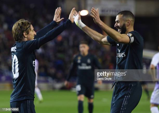 Luka Modric of Real Madrid celebrates after scoring his team's fourth goal with Karim Benzema during the La Liga match between Real Valladolid CF and...