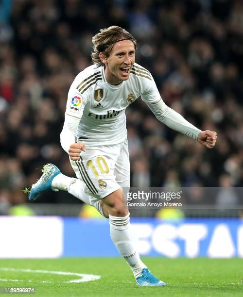 Luka Modric of Real Madrid celebrates after scoring his team's third goal during the La Liga match between Real Madrid CF and Real Sociedad at...