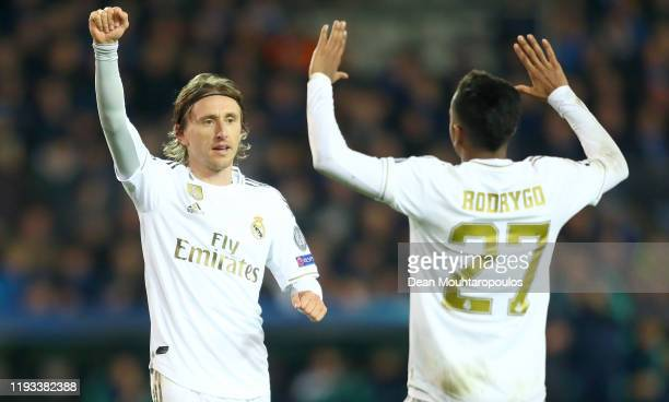 Luka Modric of Real Madrid celebrates after scoring his team's third goal with Rodrygo of Real Madrid during the UEFA Champions League group A match...