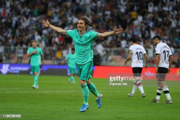 Luka Modric of Real Madrid celebrates after scoring his team's third goal during the Supercopa de Espana SemiFinal match between Valencia CF and Real...