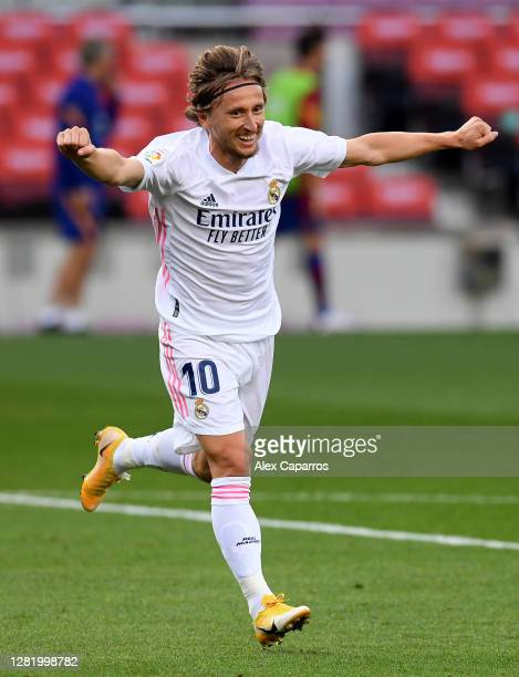 Luka Modric of Real Madrid celebrates after scoring his team's third goal during the La Liga Santander match between FC Barcelona and Real Madrid at...