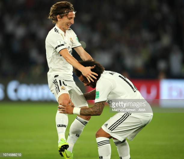 Luka Modric of Real Madrid celebrates scoring a goal to make the score 10 with Marcelo during the FIFA Club World Cup UAE final match between Real...