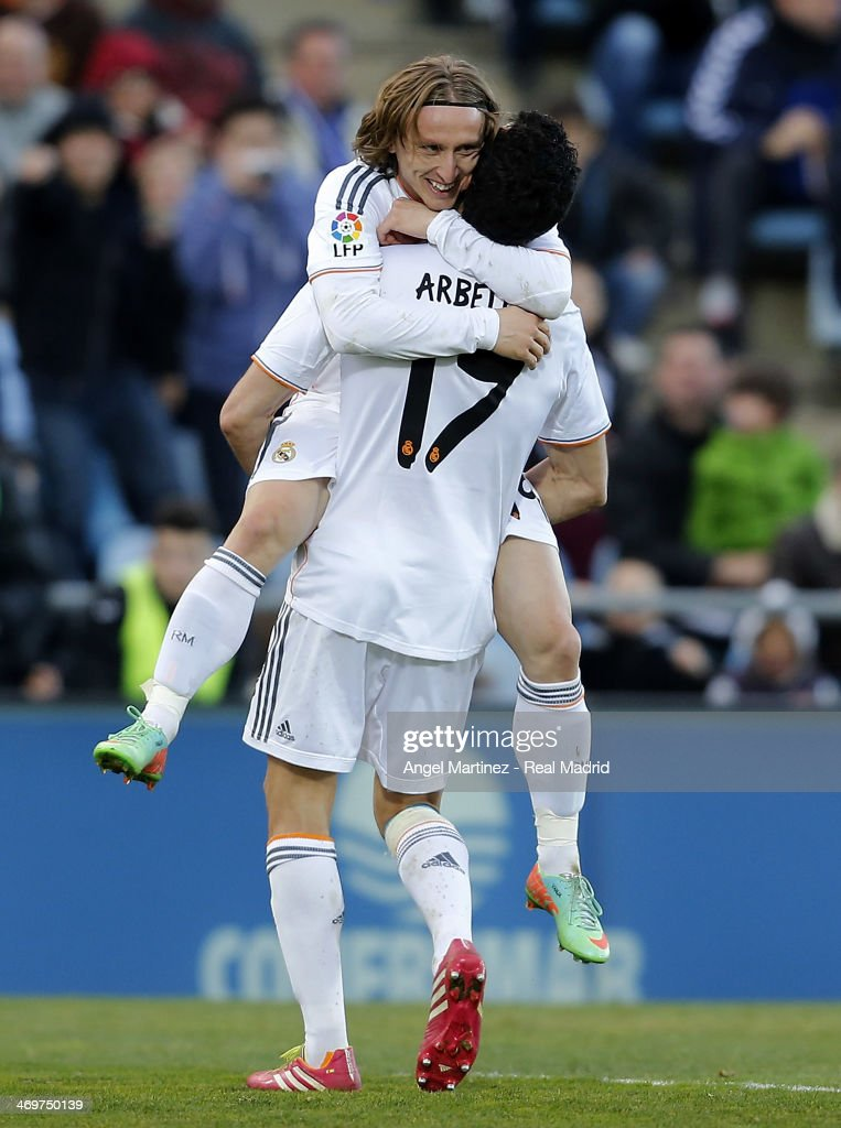 Luka Modric (Up) of Real Madrid celebrates with Alvaro Arbeloa after scoring their team's third goal during the La Liga match between Getafe and Real Madrid at Coliseum Alfonso Perez on February 16, 2014 in Getafe, Spain.